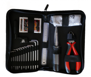 Ernie-Ball-Musician's-Toolkit-inside